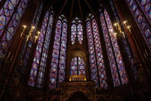 Picture of the center stained class windows around the altar of Sainte Chapelle in Paris, France.