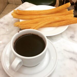 Picture of churros and hot chocolate from San Gines in Madrid, Spain.