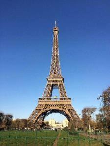 Picture of the Eiffel Tower in Paris, France with a blue sky.