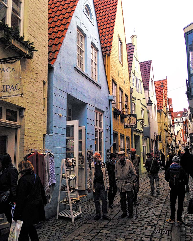 A street of colorful shops in Bremen, Germany.