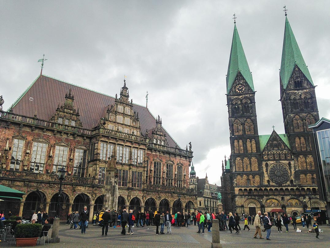 A town square in Bremen, Germany with a church and a gabled building.