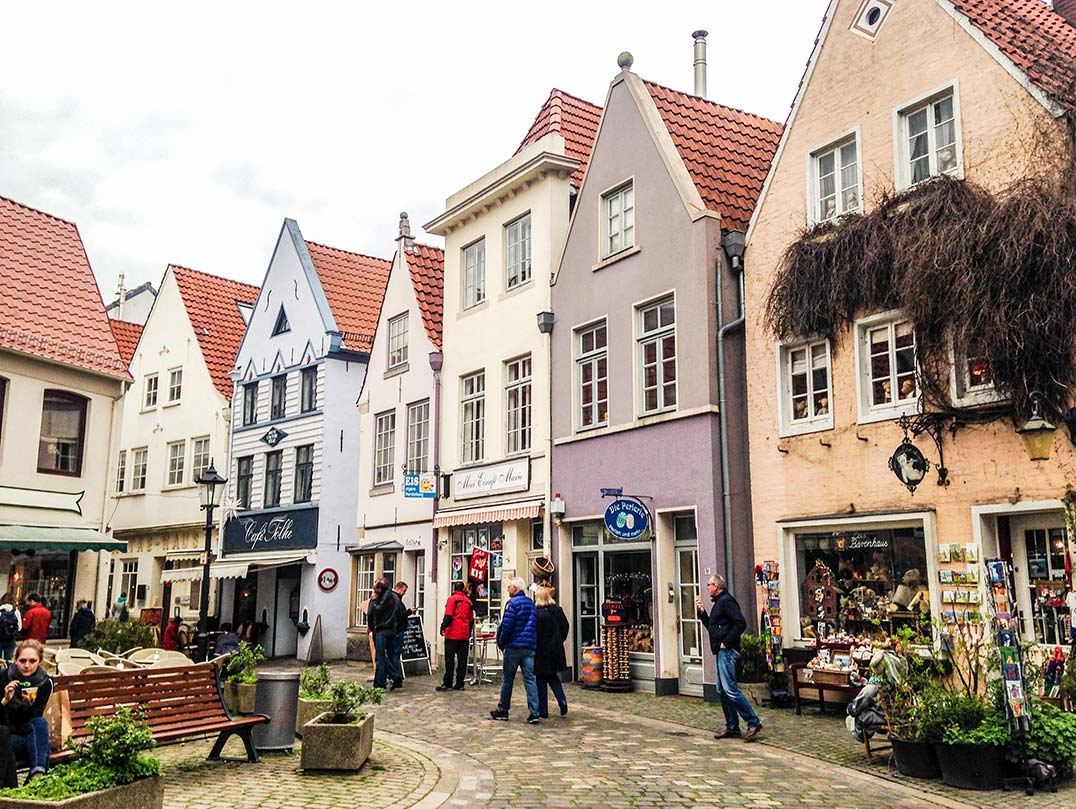 A street in Bremen, Germany lined with colorful shops.