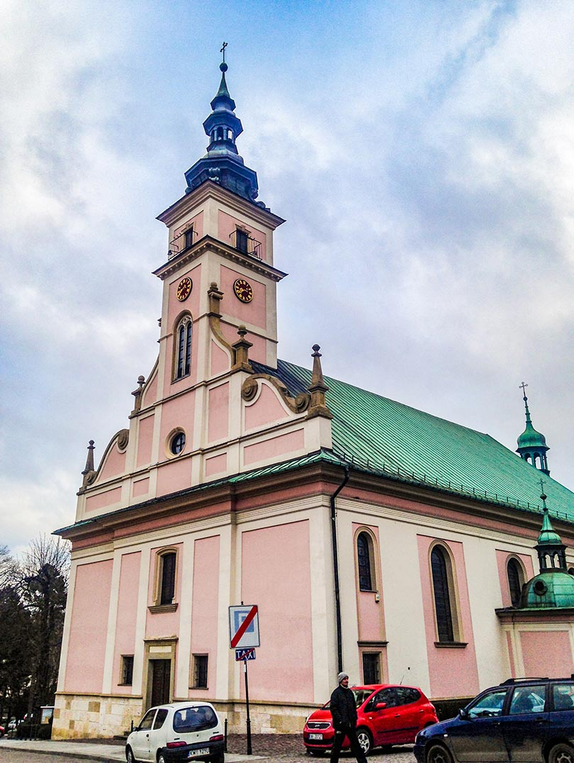 A pink church with a copper roof in Krakow, Poland.