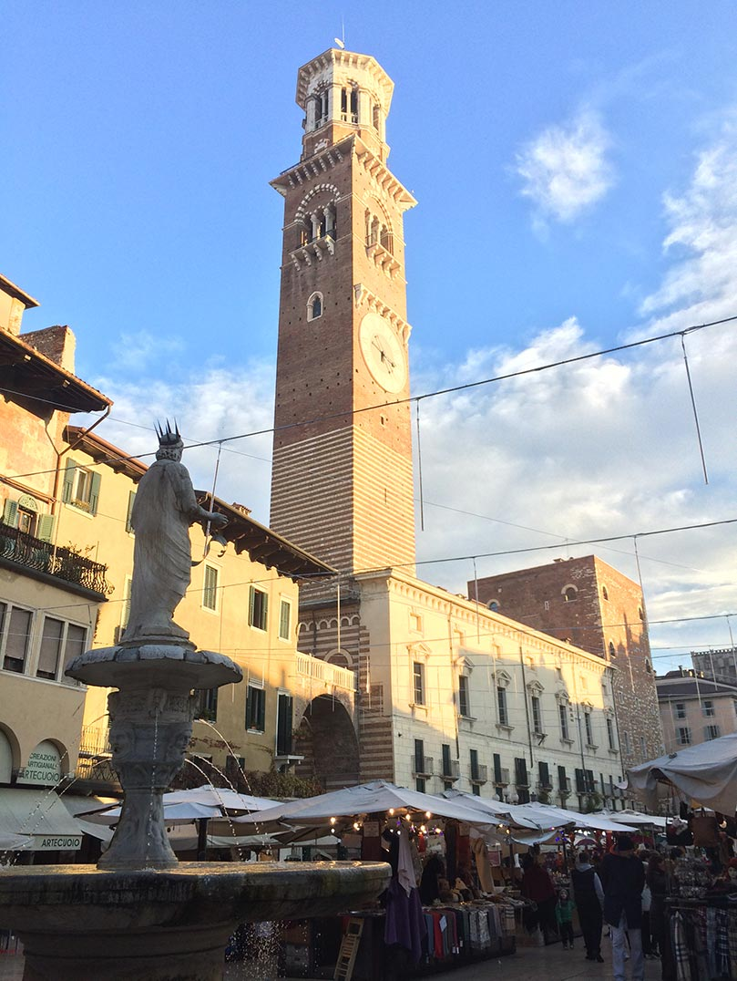 A clock tower in a piazza in Verona, Italy.