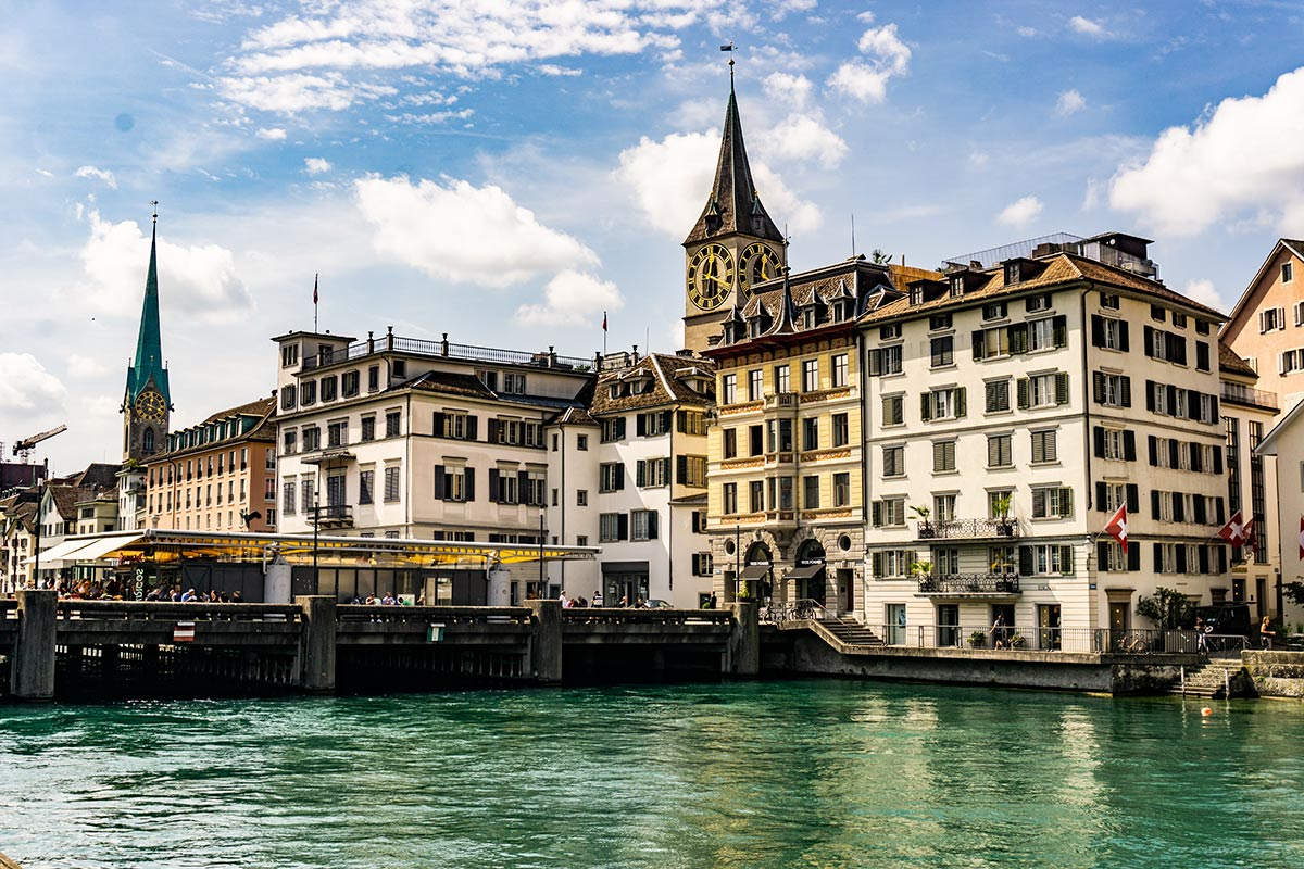 A view of the river and the warm colored city scape in Zurich, Switzerland.