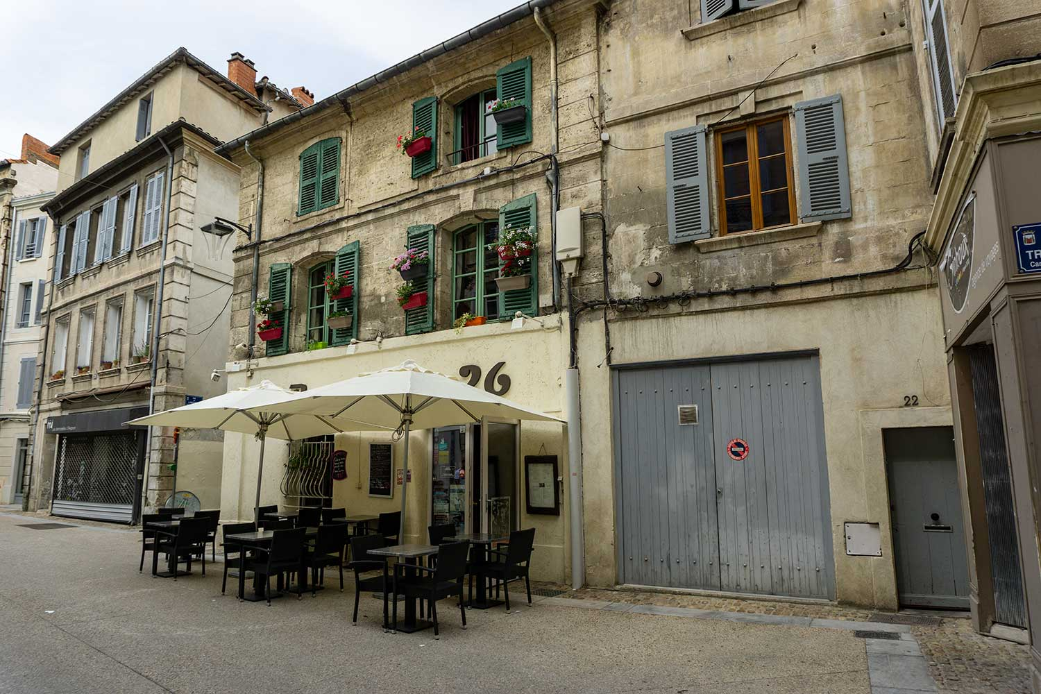 A street and cafe in Avignon, France.