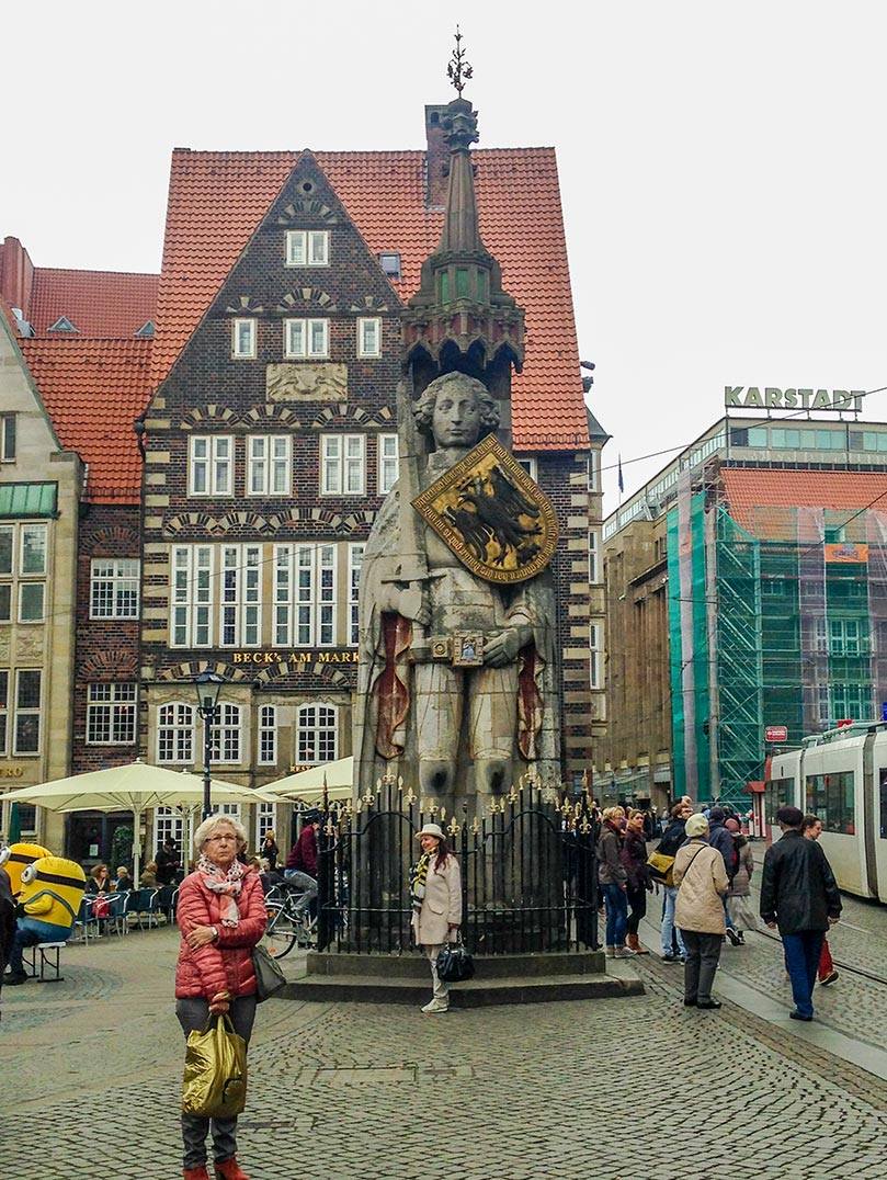 A medieval statue of a man with a shield in the town square of Bremen, Germany.
