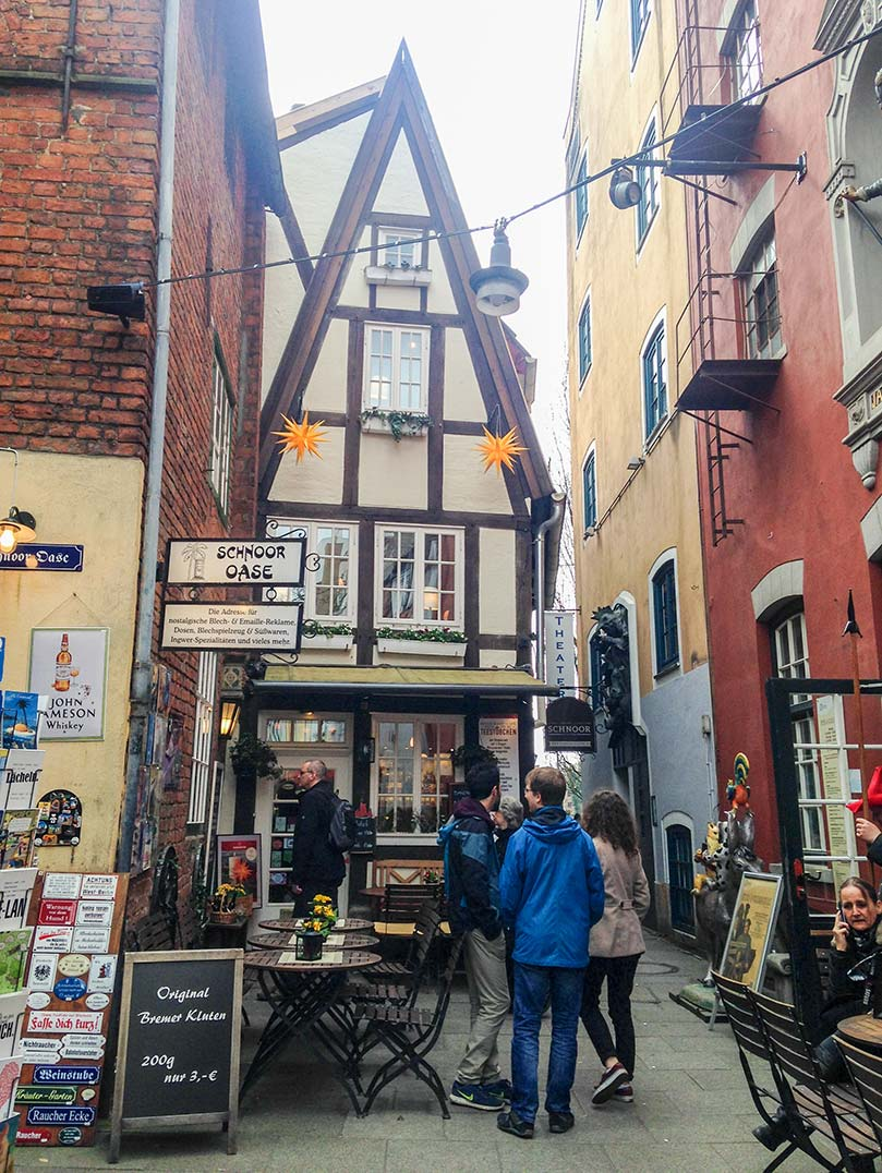 A narrow, timbered house at the end of a narrow street in Bremen, Germany.