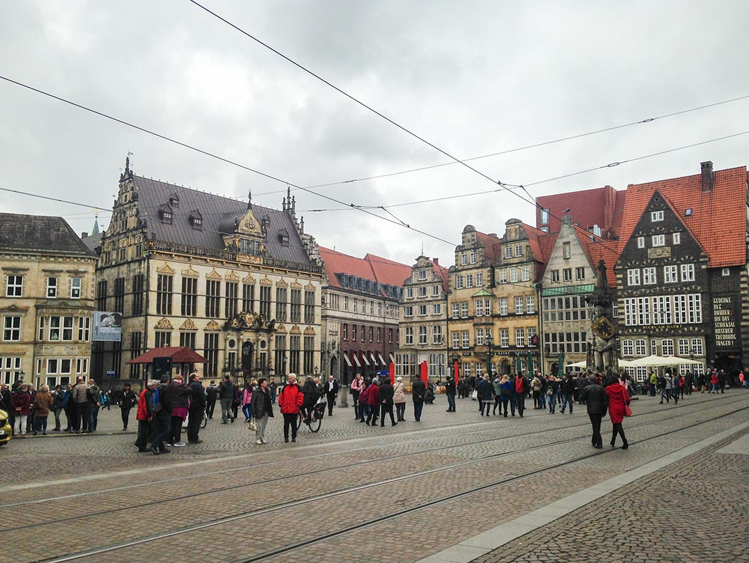 A town square in Bremen, Germany with gilded, gabled buildings.