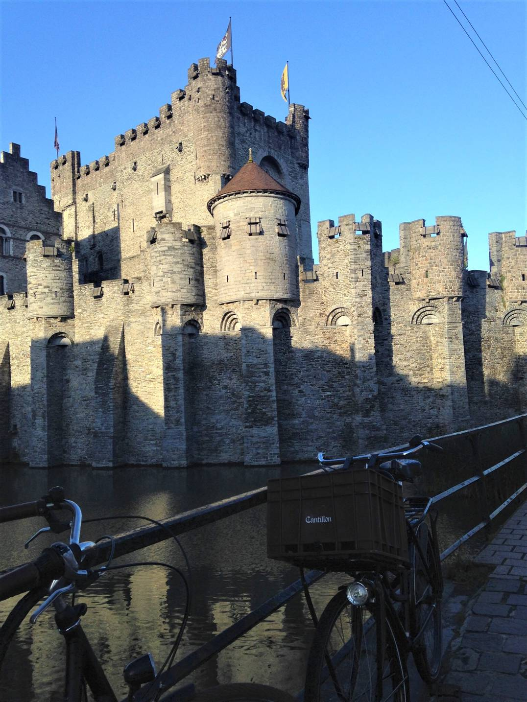 A picture of Gravensteen castle in Ghent, Belgium with a bike in the fore ground.