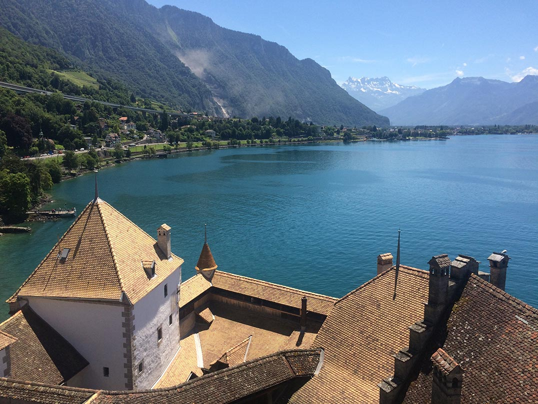 A view of mountains from the tower of Chillon Castle in Montreux, Switzerland. e tower