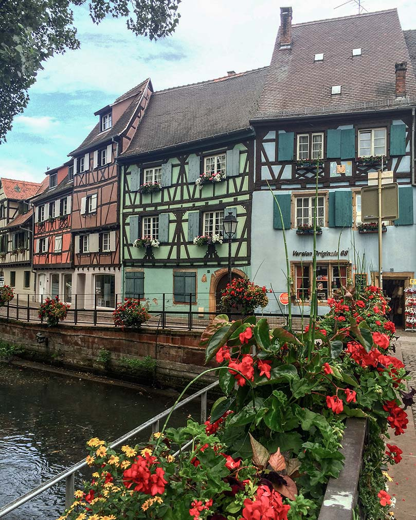 Colorful timbered houses located on a canal in Colmar, France.