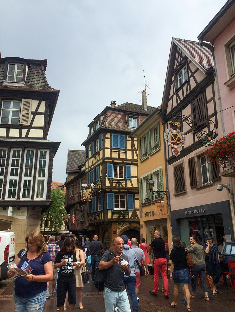 A street in Colmar, France with timbered buildings.