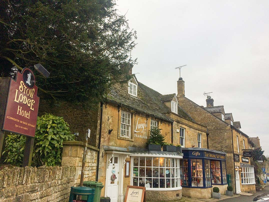 Stone buildings with glass store fronts in the Cotswolds, England.