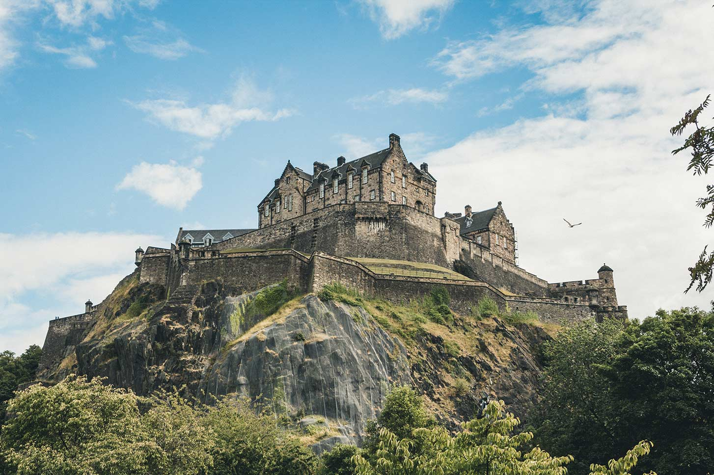 Edinburgh Castle upon a hill in Scotland.