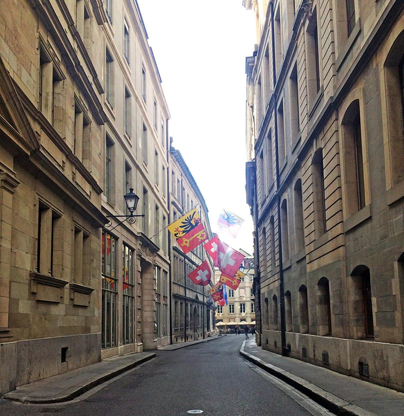 A street in Geneva, Switzerland with alternating Swiss and Geneva flags.