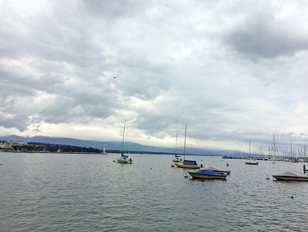 Boats on Lake Geneva on a cloudy day.