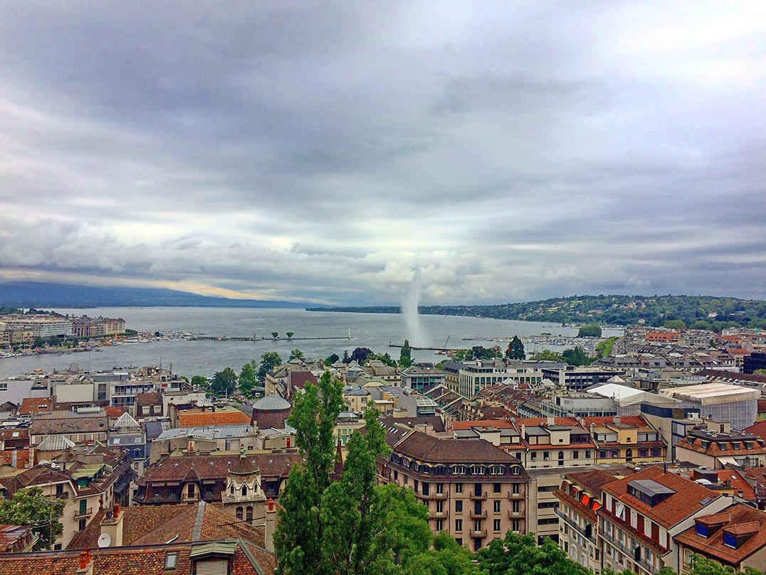 A bird's eve view of Lake Geneva and the city of Geneva as seen from a church tower.