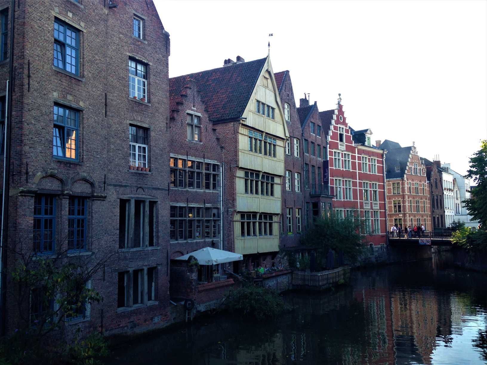 A picture of colorful buildings with gables on a canal in Ghent, Belgium.