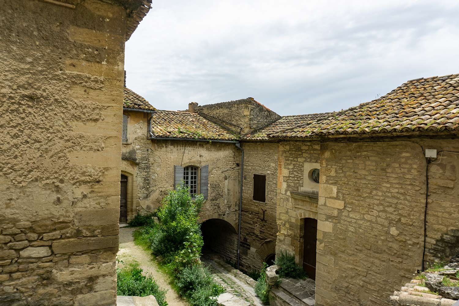 A street in Gordes, France surrounded by stone buildings.