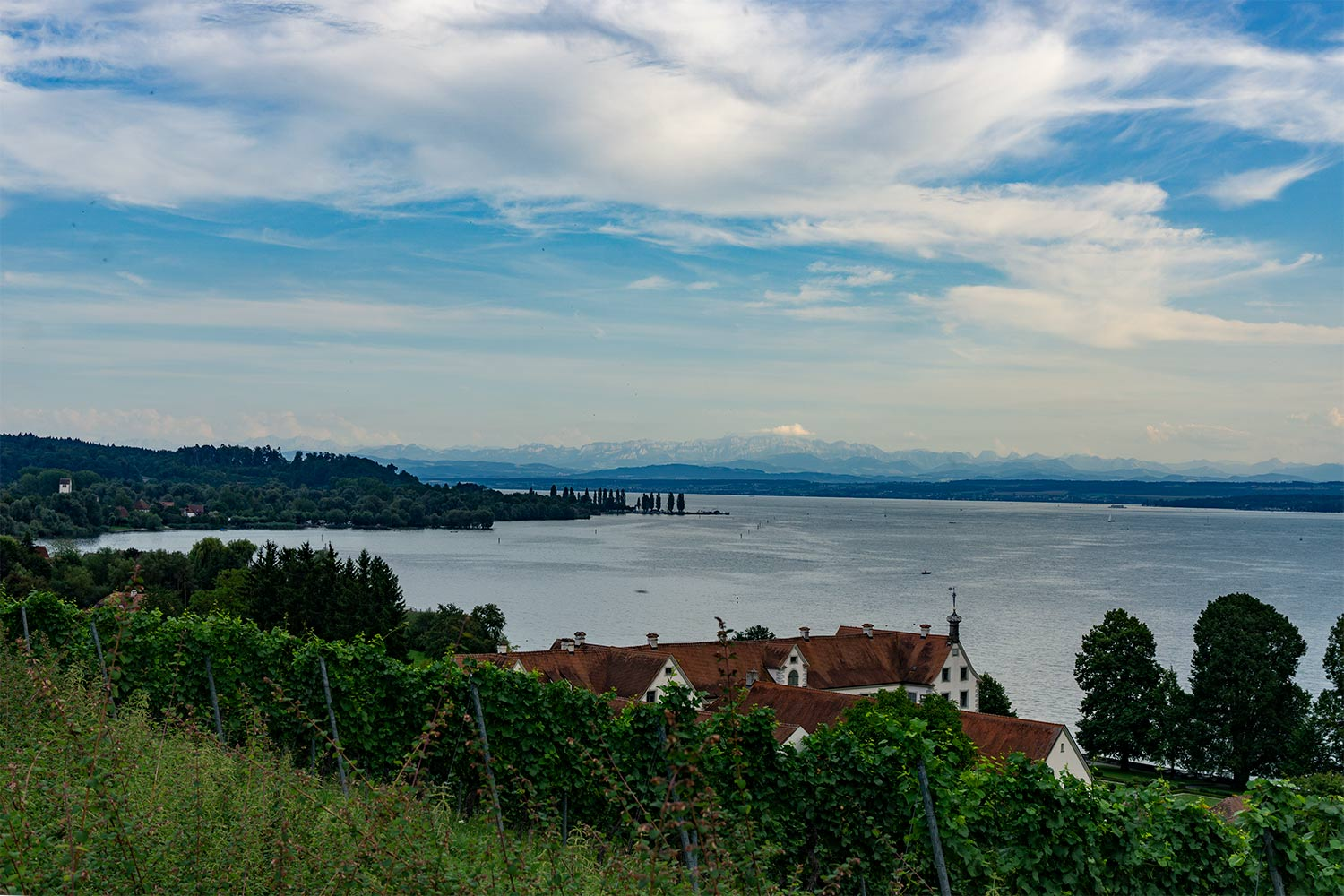 A view of Lake Konstanz with mountains in the background.