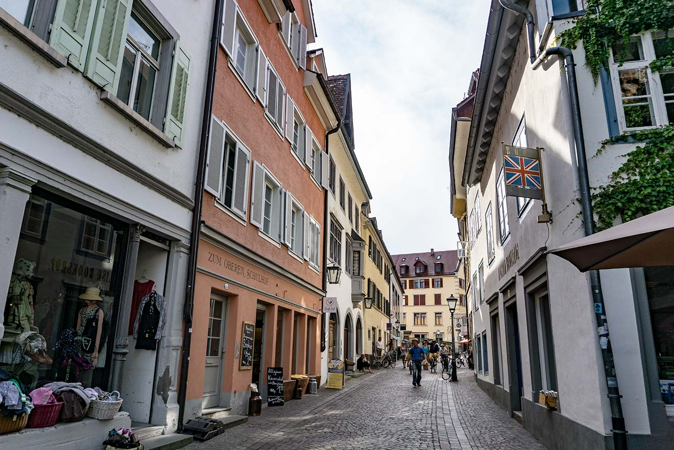 A street in Konstanz, Germany with colorful buildings and a cobblestone street.