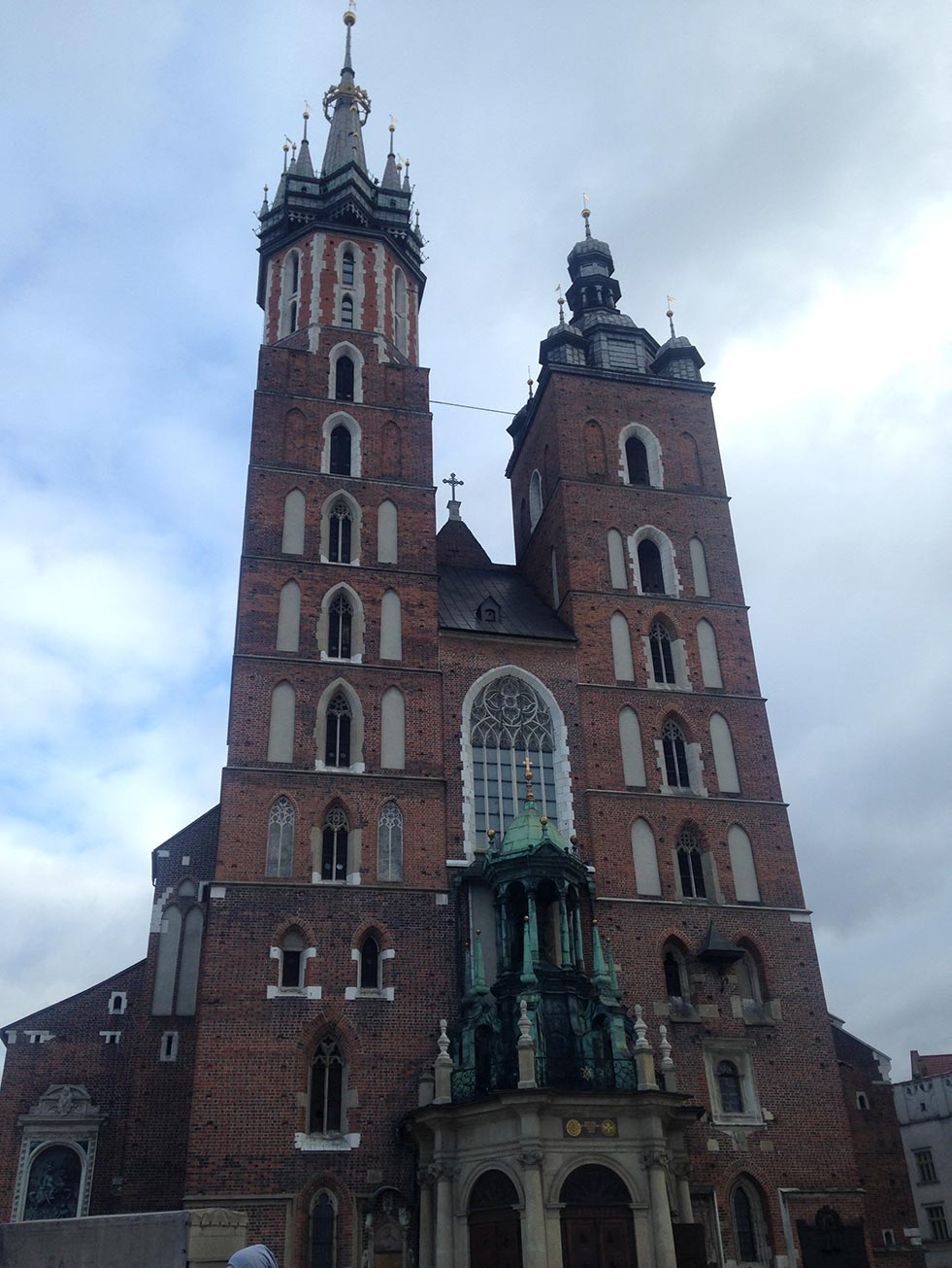 The towers of a brick church in Krakow, Poland.