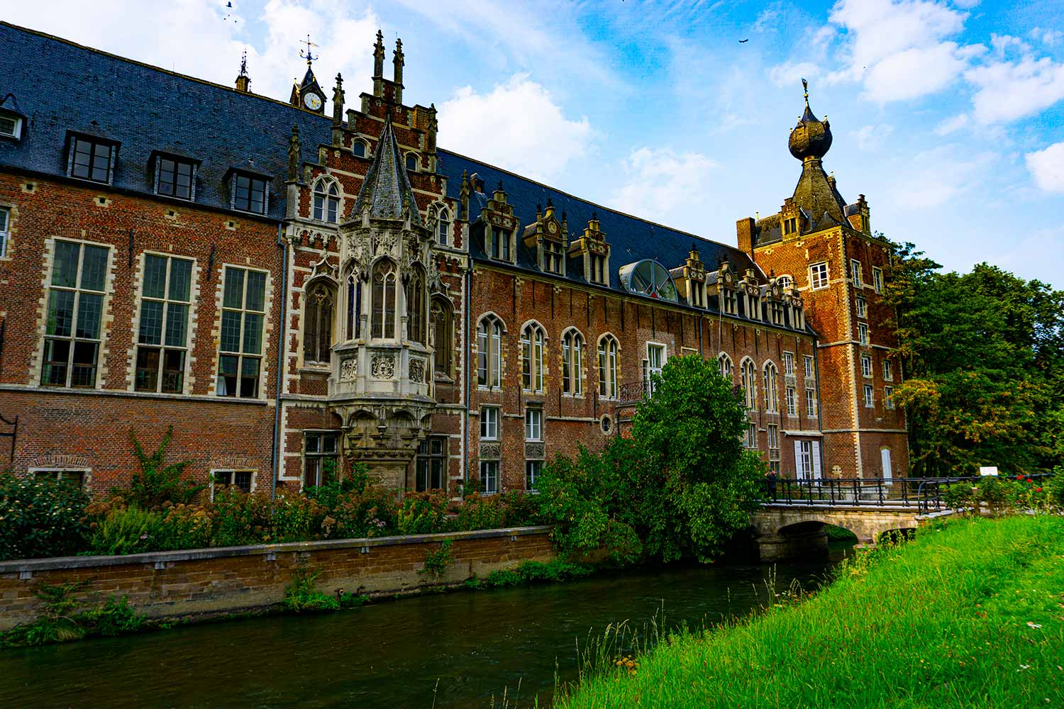 A palace in Leuven, Belgium that has a river running in front of it. It is now part of the town´s university.