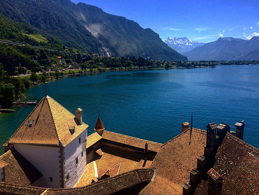 A view of the mountains from the tower of Chateau de Chillon. You can see lake Geneva and the roof of the castle.