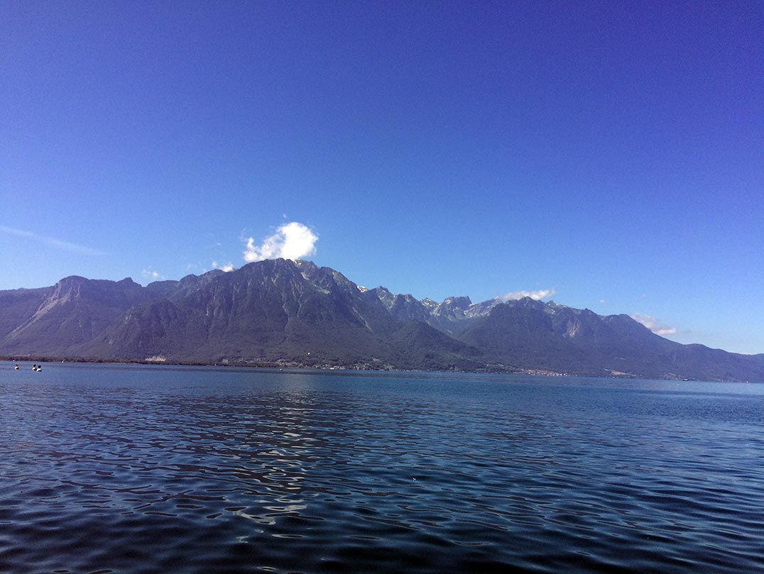 Lake Geneva with mountains in the background.