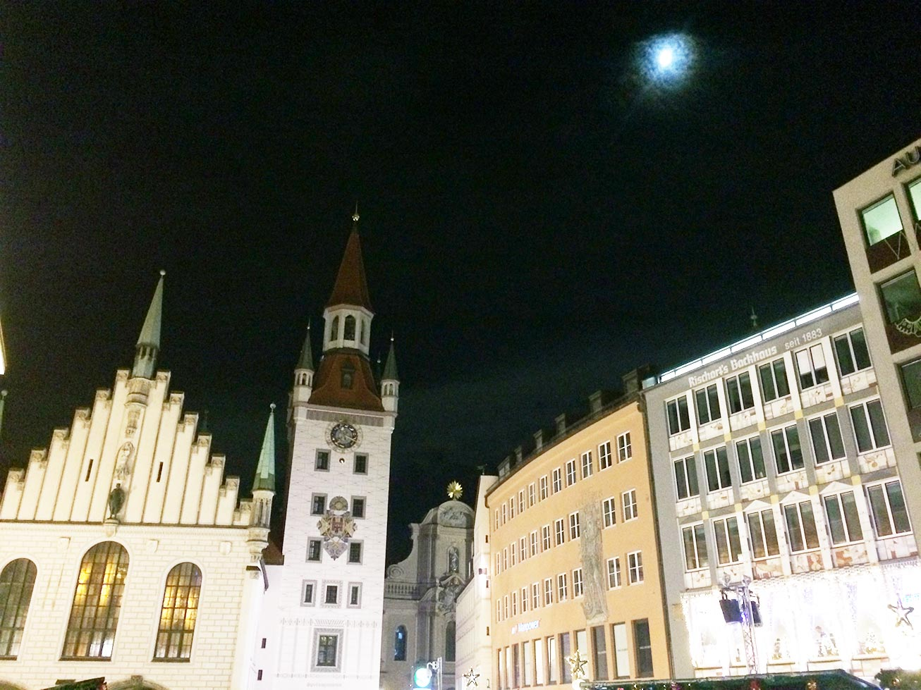 Town Square in Munich, Germany at night with a full moon.