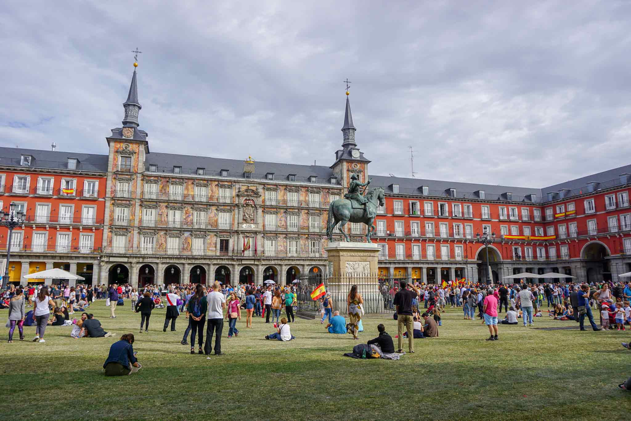 Picture of Plaza Mayor in Madrid, Spain with grass and a lot of people.