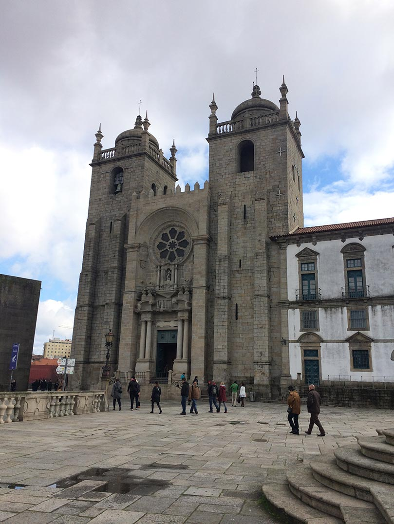 A stone church with a small rose window in Porto, Portugal.