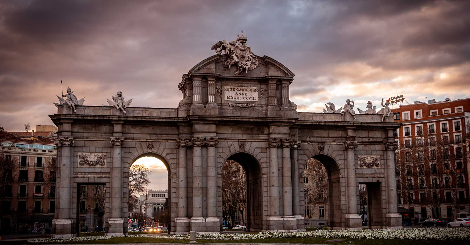 Picture of Puerta de Alcalá in Madrid. The image shows the monument during sunset.