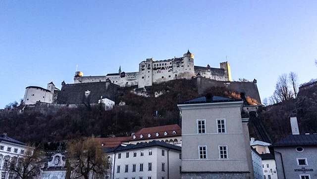 The white castle in Salzburg, Austria rising above the city of Salzburg, Austria.