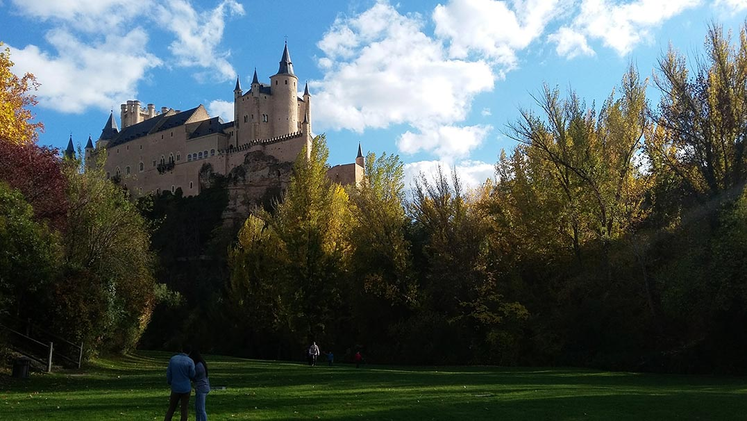 Segovia Castle in Spain seen from a park