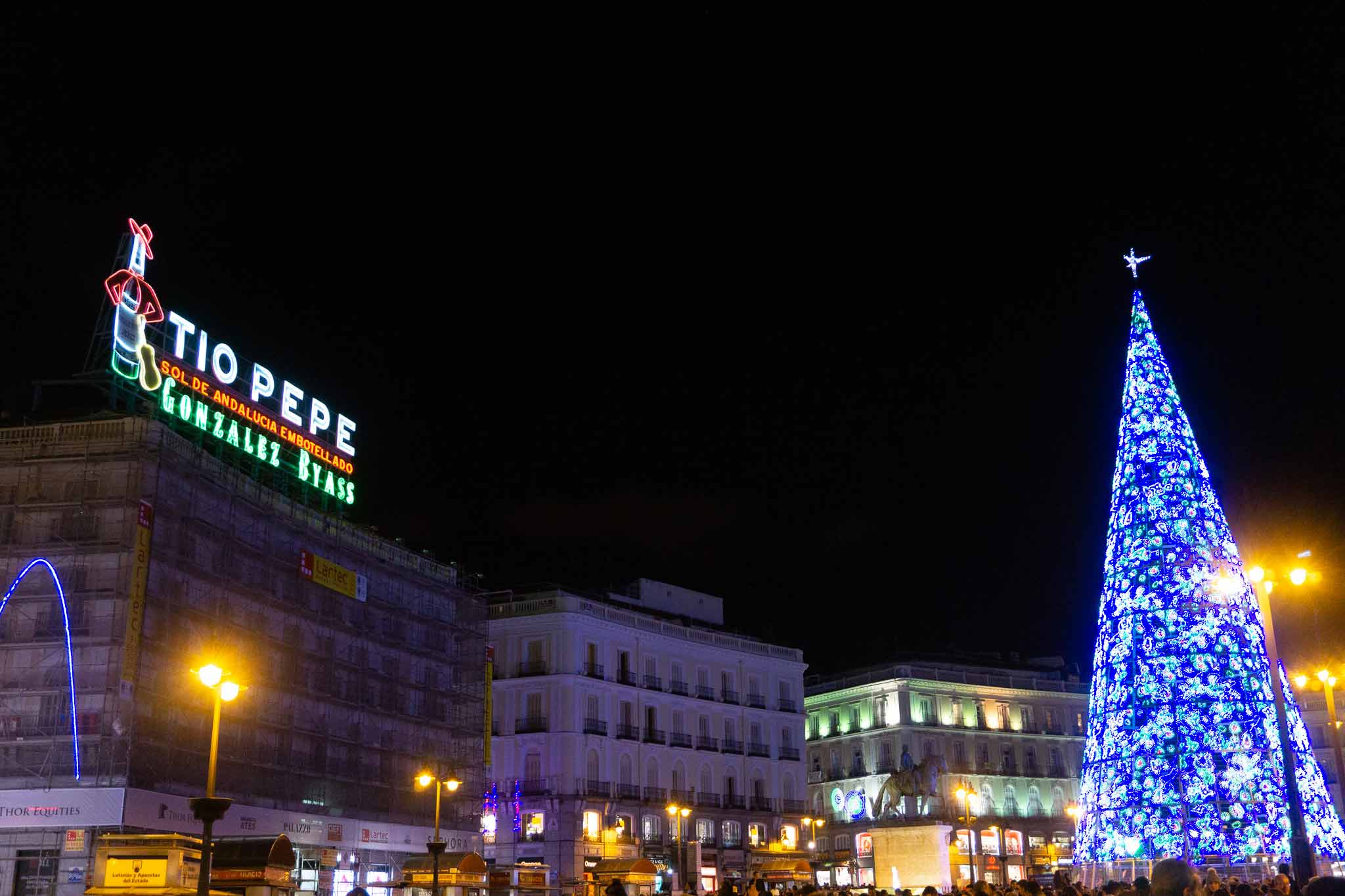 Picture of Puerta del Sol during Christmas in Madrid, Spain with the Tio Pepe sign in the background.