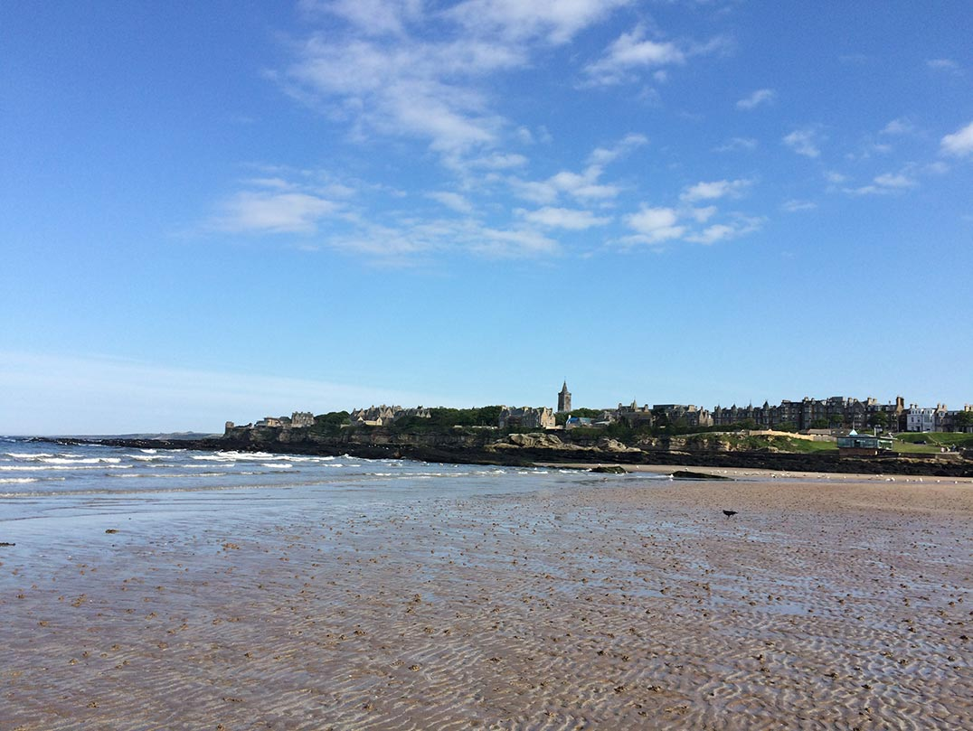 West Sands Beach in St. Andrews, Scotland with a view of the city's skyline.