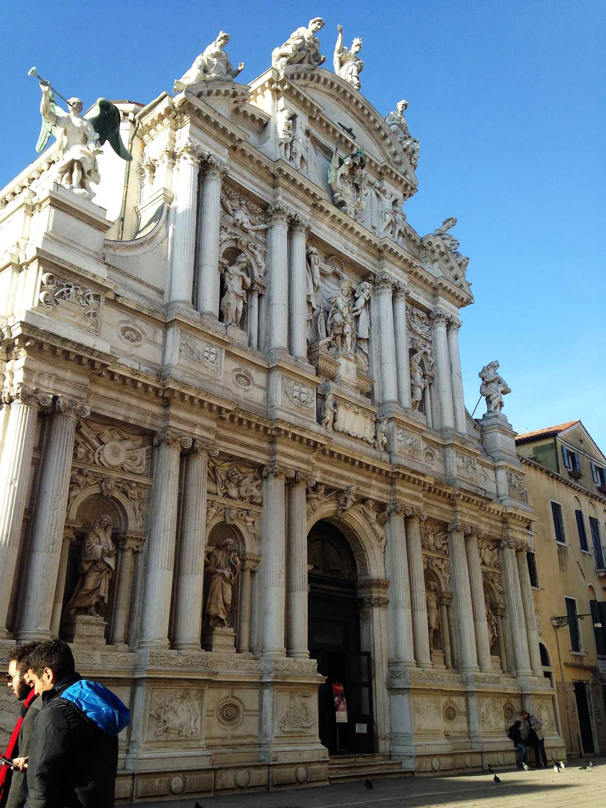 A church in Venice, Italy with a highly decorated stone facade.