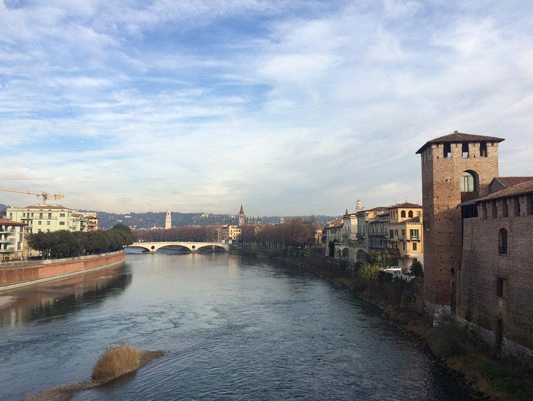 A view of the city of Verona from a bridge.