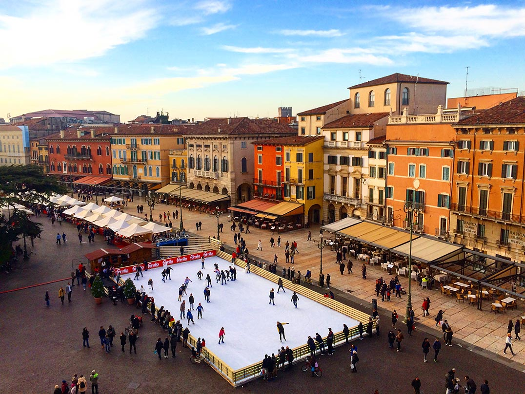 A view of a street and ice rink in Verona, Italy taken from the top of the Roman Ampitheatre.